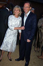DIANA DONOVAN and DAVID COLLINS at the Cartier Chelsea Flower Show dinat the annual Cartier Flower Show Diner held at The Physics Garden, Chelsea, London on 23rd May 2005.<br />