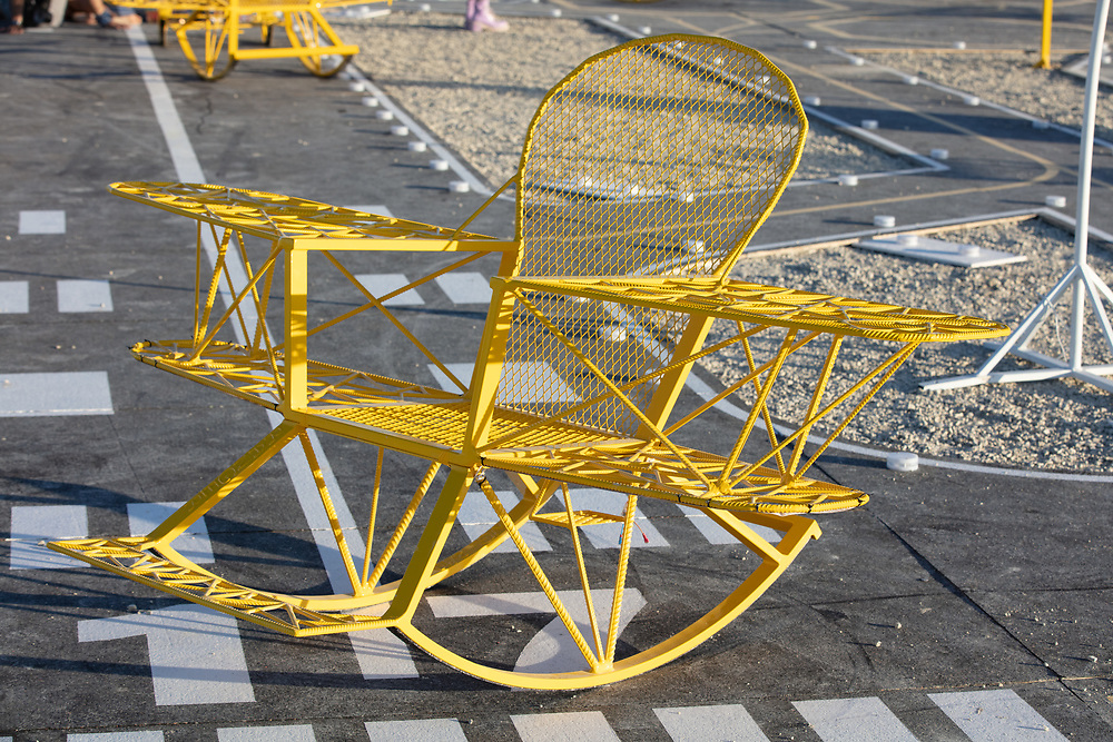"""Airfield for walking in the clouds<br /> by: Weld Queen<br /> from: Moscow, Russia<br /> year: 2019<br /> <br /> """"Airfield for walking in the clouds"""" is a model of a fantasy airfield with ten dream-liners """"Armchairs for walking in the clouds.""""<br /> The project is a large-scale interactive installation where people will be sitting and swinging in the """"Armchairs for walking in the clouds"""" where they will be able to """"break away"""" from the ground and be closer to their dreams. """"Airfield for walking in the clouds"""" is a place where people can go on their own journey into the depths of their inner space.<br /> <br /> URL: http://weldqueen.com/project/airfield-for-walking-in-the-clouds/<br /> Contact: info@weldqueen.com<br /> <br /> https://burningman.org/event/brc/2019-art-installations/?yyyy=&artType=B#a2I0V000001TAiBUAW"""