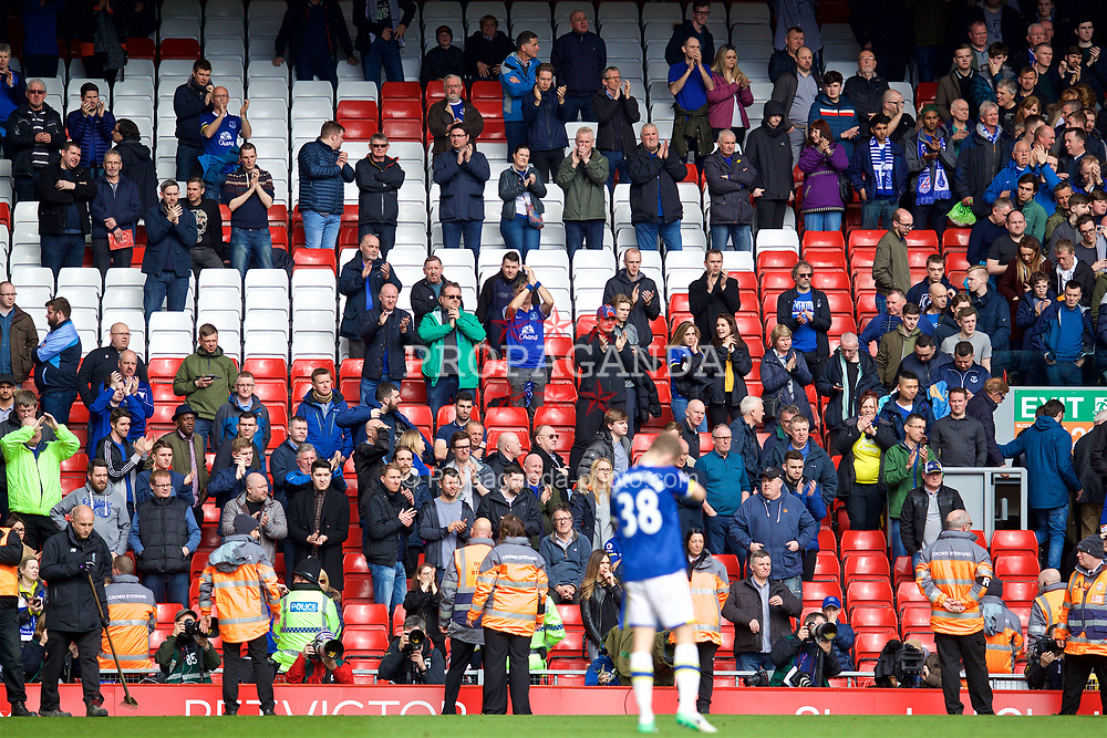 LIVERPOOL, ENGLAND - Saturday, April 1, 2017: A handful of Everton supporters remain to applaud their side after the 3-1 defeat to Liverpool during the FA Premier League match, the 228th Merseyside Derby, at Anfield. (Pic by David Rawcliffe/Propaganda)