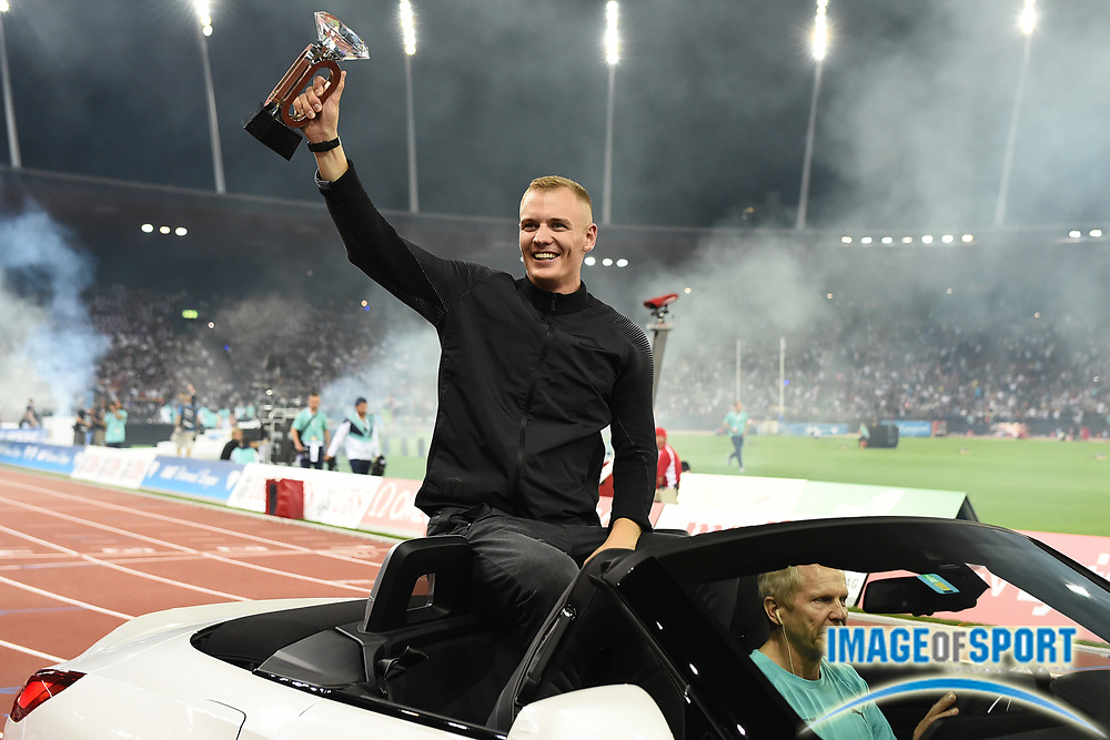Sam Kendricks (USA) takes victory lap with IAAF Diamond League championship trophy after winning the pole vault at 19-5 (5.92m)  during the Weltkasse Zurich at Letzigrund Stadium, Thursday, Aug. 29, 2019, in Zurich, Switzerland. (Jiro Mochizuki/Image of Sport)