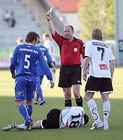 Fotball <br /> Adeccoligaen<br /> AKA Arena , Hønefoss <br /> 24.06.09<br /> Hønefoss BK  v  FK Haugesund  1-1<br /> <br /> Foto: Dagfinn Limoseth, Digitalsport<br /> <br /> Gult kort til Trygve Nygaard , Haugesund etter takling av Fridtjov Seeberg<br /> Dommer er Bernt H . Bruheim , Sprint-Jeløy SK