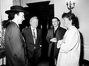 An Taoiseach Charles Haughey TD introduces his daughter Eimear to the Edge and Bono at a reception to welcome U2 home after a highly successful tour of America. The event was held in Iveagh House, Dublin, formerly a home of the Guinness family and now home to the Department of Foreign Affairs.<br />