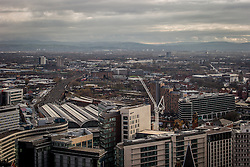 © Licensed to London News Pictures . 07/12/2013 . Piccadilly Railway Station with tracks leading south , MacDonald Hotel , Station Approach . Cityscape view of Manchester . Photo credit : Joel Goodman/LNP