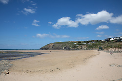 "© Licensed to London News Pictures. 11/05/2020. Newquay, UK. Mawgan Porth beach on the North coast of Cornwall is nearly empty, the day after British Prime Minister Boris Johnson announced a 'road map' to lift lockdown restrictions due to Covid-19, (Coronavirus). A rise in ""staycations"" - the concept of holidaying in your home country rather than travelling abroad - is expected, with many visitors planning to visit Cornwall. However, an ongoing campaign titled ""#ComeBackLater"" is trying to persuade tourists not to visit the county until it is safe to do so. Photo credit : Tom Nicholson/LNP"