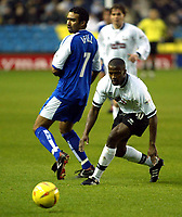 Photo. Chris Ratcliffe<br />Millwall v Derby County. FA Nationwide 1st Division. 22/11/2003<br />Paul ifill of Millwall and Michael Johnson of Derby watch the ball