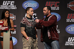 August 27, 2010; Boston, MA; USA; Frankie Edgar speaks with Joe Rogan after weighing in for his bout against BJ Penn at UFC 118 in Boston, MA