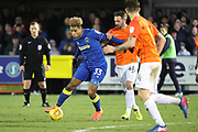 AFC Wimbledon striker Lyle Taylor (33) holding off Southend United defender John White (48) during the EFL Sky Bet League 1 match between AFC Wimbledon and Southend United at the Cherry Red Records Stadium, Kingston, England on 1 January 2018. Photo by Matthew Redman.