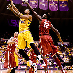Jan 30, 2016; Baton Rouge, LA, USA; LSU Tigers forward Craig Victor II (32) shoots over Oklahoma Sooners forward Khadeem Lattin (12) during the first half of a game at the Pete Maravich Assembly Center. Mandatory Credit: Derick E. Hingle-USA TODAY Sports