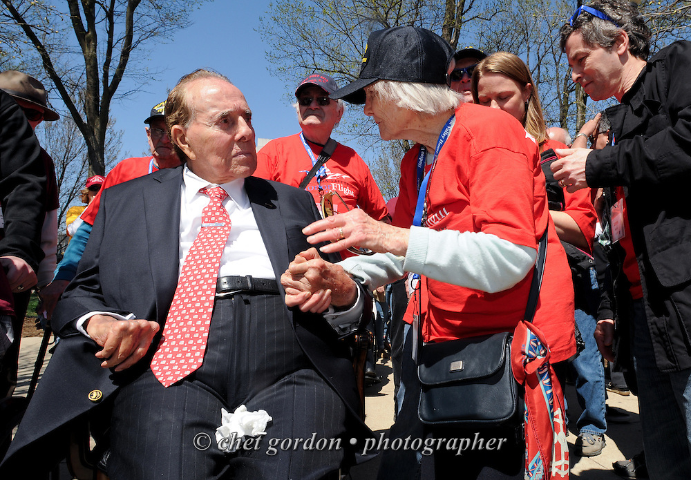 WWII Veterans and their escorts onboard the Hudson Valley Honor Flight greet former U.S. Senator Bob Dole at the World War II Memorial in Washington, DC on Saturday, April 11, 2015. Nearly 100 Veterans from the Orange County (NY) region toured the WWII, Korean, Vietnam, and USMC War Memorials, as well as Arlington National Cemetery. Hudson Valley Honor Flight is a chapter of the Honor Flight Network, which provides free flights for WWII Veterans and tours of the WWII Memorial constructed in their honor, and other sites in the nation's capital.  © Chet Gordon for Hudson Valley Honor Flight
