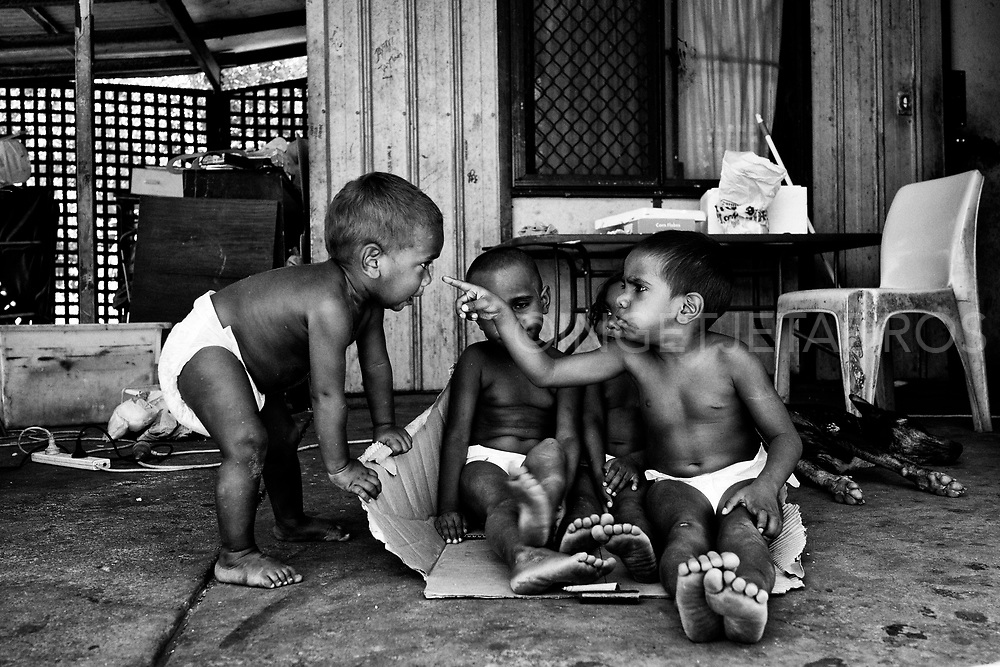 Kids playing at their family home in the Mallingbarr (Kennedy Hill) community.  Despite poverty children are being children. Quane (1 yr), Meah (3 yr), Kitana (3 yr) and Marjorie (4 yr) (from L to R), Broome, Western Australia.