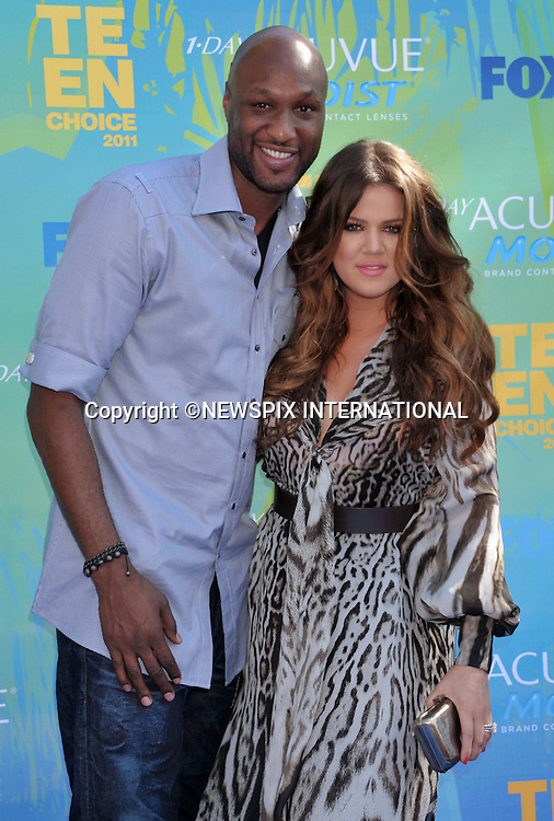 "KHLOE KARDASHIAN AND LAMAR ODOM.attends the Teen Choice 2011 at the Gibson Amphitheatre, Universal City, California_07/08/2011.Mandatory Photo Credit: ©Crosby/Newspix International. .**ALL FEES PAYABLE TO: ""NEWSPIX INTERNATIONAL""**..PHOTO CREDIT MANDATORY!!: NEWSPIX INTERNATIONAL(Failure to credit will incur a surcharge of 100% of reproduction fees).IMMEDIATE CONFIRMATION OF USAGE REQUIRED:.Newspix International, 31 Chinnery Hill, Bishop's Stortford, ENGLAND CM23 3PS.Tel:+441279 324672  ; Fax: +441279656877.Mobile:  0777568 1153.e-mail: info@newspixinternational.co.uk"