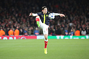 Arsenal defender Hector Bellerin (24) controlling the ball during warm up during the Champions League round of 16, game 2 match between Arsenal and Bayern Munich at the Emirates Stadium, London, England on 7 March 2017. Photo by Matthew Redman.