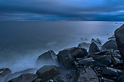 Waves crashing along the shoreline along the Gulf of St. Lawrence in storm light<br />Ruisseau Castor<br />Quebec<br />Canada