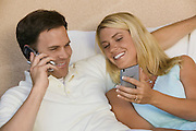 Couple Using Cell Phone and PDA