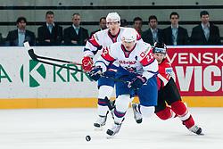 Marcel Rodman of Slovenia and Thomas Koch of Austri during ice-hockey match between Austria and Slovenia at IIHF World Championship DIV. I Group A Slovenia 2012, on April 21, 2012 at SRC Stozice, Ljubljana, Slovenia. (Photo By Matic Klansek Velej / Sportida.com)