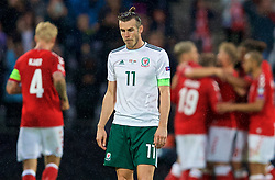 AARHUS, DENMARK - Sunday, September 9, 2018: Wales' captain Gareth Bale looks dejected as Denmark score a second goal during the UEFA Nations League Group Stage League B Group 4 match between Denmark and Wales at the Aarhus Stadion. (Pic by David Rawcliffe/Propaganda)