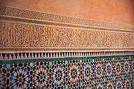 Interior close-up from the courtyard walls at the Ben Youssef Medersa school in the medina of Marrakesh, Morocco.