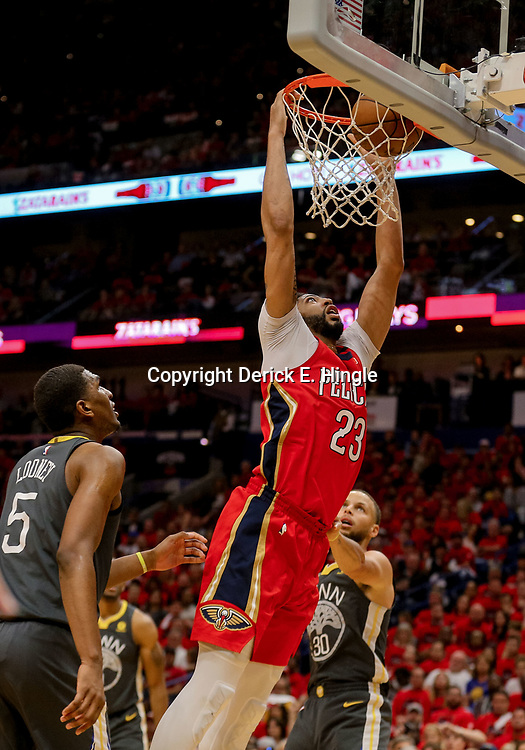 May 4, 2018; New Orleans, LA, USA; New Orleans Pelicans forward Anthony Davis (23) dunks over Golden State Warriors guard Stephen Curry (30) and forward Kevon Looney (5) during the fourth quarter in game three of the second round of the 2018 NBA Playoffs at Smoothie King Center. The Pelicans defeated the Warriors 119-100. Mandatory Credit: Derick E. Hingle-USA TODAY Sports
