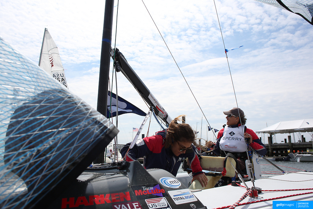 Skipper Sarah Everhart Skeels, (right), Tiverton, RI, and Cindy Walker, Middletown, RI, the only all female team competing in The Skud 18 class, preparing for competition during the C. Thomas Clagett, Jr. Memorial Clinic & Regatta at Newport, Rhode Island hosted by Sail Newport at Fort Adams. <br /> The Clagett is North America's premier event for sailors with disabilities with sailors competing in the 3 Paralympic class boats and is an integral part of preparation for athletes preparing for  Paralympic and world championship racing. Newport, Rhode Island, USA. 26th June 2015. Photo Tim Clayton