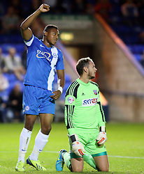 Peterborough United's Britt Assombalonga celebrates after Brentford's Martin Taylor scored an own goal - Photo mandatory by-line: Joe Dent/JMP - Tel: Mobile: 07966 386802 08/10/2013 - SPORT - FOOTBALL - London Road Stadium - Peterborough - Peterborough United V Brentford - Johnstone's Paint Trophy