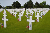06 Jun 1994 --- Rows of white crosses with American and French flags in the American Cemetery at Coleville-sur-Mer, Normandy, France. --- Image by © Owen Franken/Corbis