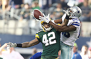 Green Bay Packers strong safety Morgan Burnett (42) jumps to break up a pass intended for Dallas Cowboys wide receiver Dez Bryant (88) during the Green Bay Packers against the Dallas Cowboys  NFL game in Dallas, Texas Sunday, December, 15, 2013. (AP Photo/Tom Hauck)