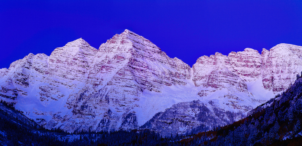 First dusting of fall snow on the Maroon Bells in Aspen, Colorado,