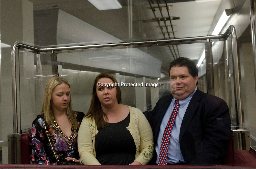 Representative Blake Farenthold(R-TX)(R) rides the train with daugters Amanda and Morgan through the underground tunnel from his office in the Rayburn House Office Building to the US Capitol to be sworn in with the 112th Congress on January 5, 2010. Photo by Kris Connor
