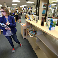 Grace Hall, Lee County Library children's librarian, puts books back on the shelf after children's storytime at the Library. Children's story time is at 10 am every Thursday and open to the public.