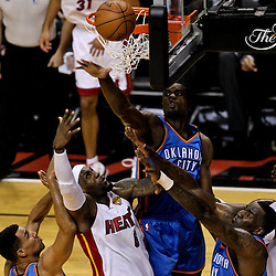 Jun 19, 2012; Miami, FL, USA; Miami Heat small forward LeBron James (6) shoots between Oklahoma City Thunder shooting guard Thabo Sefolosha (2) and center Kendrick Perkins (5) and power forward Serge Ibaka (9) during the first quarter in game four in the 2012 NBA Finals at the American Airlines Arena. Mandatory Credit: Derick E. Hingle-US PRESSWIRE