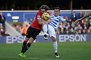 Daley Blind of Manchester United intercepts Eduardo Vargas of QPR shot. Barclays Premier league match, Queens Park Rangers v Manchester Utd at Loftus Road in London on Saturday 17th Jan 2015. pic by John Patrick Fletcher, Andrew Orchard sports photography.