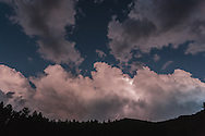 Twilight lightning storm over the forest and mountains south of the Valle Grande, Valles Caldera National Preserve, © 2006 David A. Ponton