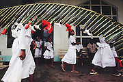 Children leave the Poutasi Village church after the annual White Sunday celebration. White Sunday (also called Children's Day) is celebrated on the second Sunday of October each year. In this tradition brought to the island by the London Missionary Society, the children receive new clothes and gifts, and festive games are played. Most attend church services and then gather for family feasts that feature foods like pork, taro, and coconuts. Western Samoa. Material World Project.