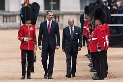 © Licensed to London News Pictures. 12/07/2017. London, UK. HIS MAJESTY KING FELIPE VI OF SPAIN and The DUKE OF EDINBURGH attend the Ceremonial Welcome at Horse Guards Parade for His Majesty King Felipe VI of Spain and Her Majesty Queen Letizia during a three day State visit. Photo credit: Ray Tang/LNP