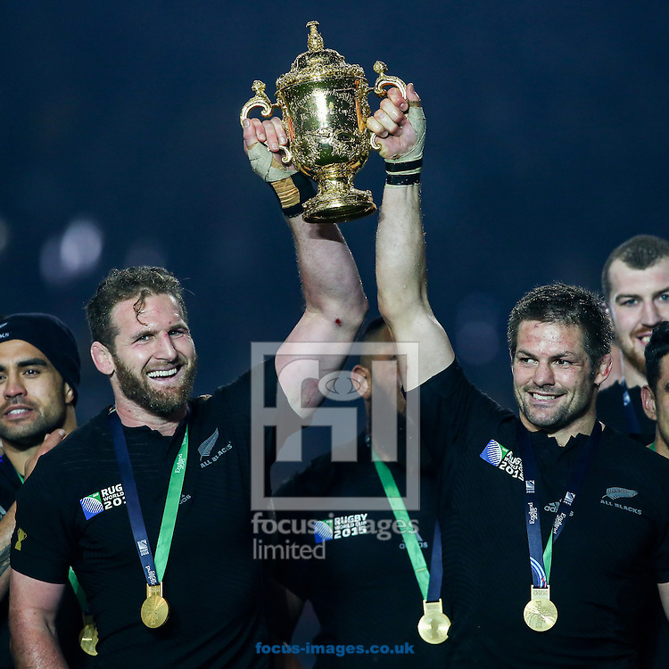Kieran Read of New Zealand (left) and Richie McCaw of New Zealand (right) hold the World Cup trophy aloft after the final of the 2015 Rugby World Cup at Twickenham Stadium, Twickenham<br /> Picture by Andy Kearns/Focus Images Ltd 0781 864 4264<br /> 31/10/2015