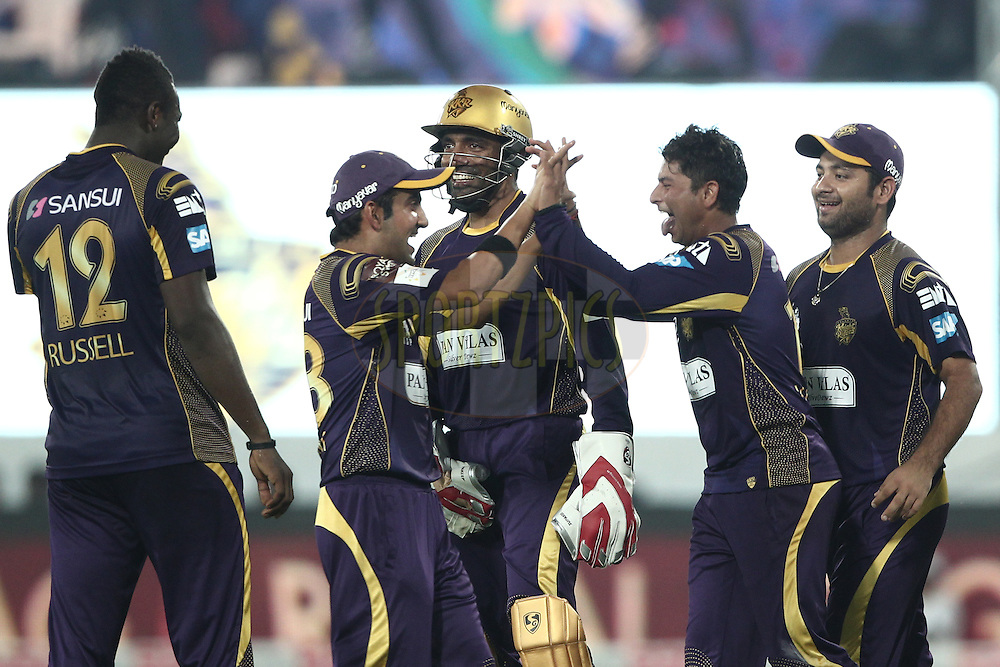 Gautam Gambhir , Kuldeep Singh Yadav , Robin Uthappa of the Kolkata Knight Riders celebrates the wicket of  Nathan Coulter-Nile of Perth Scorchers during match 10 of the Oppo Champions League Twenty20 between the Kolkata Knight Riders and the Perth Scorchers held at the Rajiv Gandhi Cricket Stadium, Hyderabad, India on the 24th September 2014<br /> <br /> Photo by:  Deepak Malik / Sportzpics/ CLT20<br /> <br /> <br /> Image use is subject to the terms and conditions as laid out by the BCCI/ CLT20.  The terms and conditions can be downloaded here:<br /> <br /> http://sportzpics.photoshelter.com/gallery/CLT20-Image-Terms-and-Conditions-2014/G0000IfNJn535VPU/C0000QhhKadWcjYs