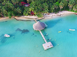 EXCLUSIVE: How about owning your own tropical Caribbean luxury resort for just $10. American couple Suzanne and Dave Smith are selling off their incredible Casa Cayuco Eco Adventure Lodge, in Bocas del Toro, Panama, Central America. But instead of listing their stunning multi-million-pound island getaway for sale they are offering the chance for anyone who buys a $10 ticket to win their extraordinary lifestyle and profitable business. Dave and Suzanne have spent five years turning a former rustic lodge into one that has just been voted number one resort on TripAdvisor in Panama. Their incredible two-acre slice of heaven is bordered by sloth-filled rainforest to the rear and crystal clear coral sea to the front. The lucky winner of the 24-guest resort will become owner of four stand-alone cabins, a main lodge, two lodge suites, and an air-conditioned luxury owner's suite designed by Dave and Suzanne themselves and built by skilled local carpenters. Outside, Casa Cayuco comes with its own jetty and thatch covered sun terrace as well as everything you need to run a business, including commercial kitchen communication tower, laundry and maintenance building and THREE power boats, each over 23-foot long. Kayaks, snorkelling, spear fishing and paddle boards and surf gear are also ready and waiting to be used by a new owner and guests alike. And if that's not enough, British competition organisers WinThis.Life https://winthis.life/index.aspx# are offering a $50,000 cash injection to welcome the new owners. All those wishing to take part have to do is buy one or more tickets and play a spot-the-ball-type competition on the website. Entries are being taken extension until April 11. Dave, 35, and Suzanne, 33, first arrived on the island in 2013 with just seven suitcases having decided to sell up from their home and corporate lives near Detroit, Michigan, USA. 16 Feb 2018 Pictured: Pic shows stunning Caribbean resort Casa Cayuco in Panama from above which one lucky winner
