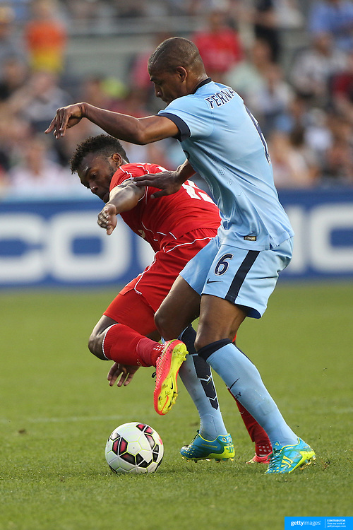 Daniel Sturridge, (left), Liverpool, challenged by Fernando, Manchester City, during the Manchester City Vs Liverpool FC Guinness International Champions Cup match at Yankee Stadium, The Bronx, New York, USA. 30th July 2014. Photo Tim Clayton