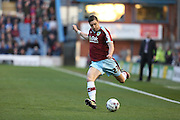 Stephen Ward of Burnley tries a cross during the Sky Bet Championship match between Burnley and Middlesbrough at Turf Moor, Burnley, England on 19 April 2016. Photo by Simon Brady.