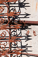 Rusty ornamental iron and shadows in the Valle Onsernone in Ticino, Southern Switzerland.