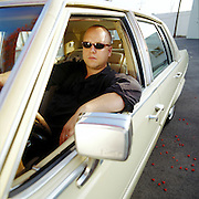 Frank Black- former frontman of the Pixies - photographed with his Cadillac in Los Angeles, CA., 2002.
