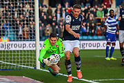Millwall defender Shaun Hutchinson (4) tussles with Reading goalkeeper Rafael Cabral Barbosa (33) during the EFL Sky Bet Championship match between Millwall and Reading at The Den, London, England on 18 January 2020.
