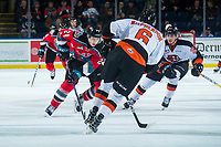 KELOWNA, CANADA - NOVEMBER 25: Kyle Topping #24 of the Kelowna Rockets is checked by Dylan MacPherson #6 of the Medicine Hat Tigers on November 25, 2017 at Prospera Place in Kelowna, British Columbia, Canada.  (Photo by Marissa Baecker/Shoot the Breeze)  *** Local Caption ***