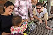 ICS volunteer Dan Hensman entertaining the children in his host home, in the village of in Banteay Char, near Battambang, Cambodia.