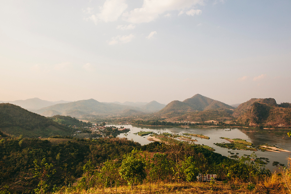 Evening walk up hillside above the Mekong river overlooking Pak Chom village and Laos