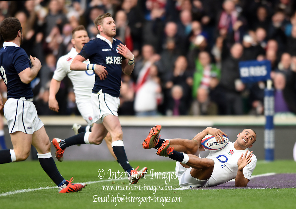 Twickenham, Great Britain, England Jonathan JOSEPH rolls over the line to score a first half try, during the Six Nations Rugby England vs Scotland, played at the RFU Stadium, Twickenham, ENGLAND. Saturday 14/03/2015<br /> <br /> [Mandatory Credit; Peter Spurrier/Intersport-images]