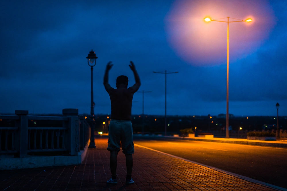 The first shot I made on an amazing 3 day photo tour in Central Vietnam last weekend with @picsofasia. <br /> <br /> A man exercises at daybreak on Cua Dai Bridge, just outside of Hoi An. I found the contrast of the rising blue sky and the yellow street lamps to be very cinematic. <br /> <br /> I&rsquo;ll have many more images to share this week so stay tuned!