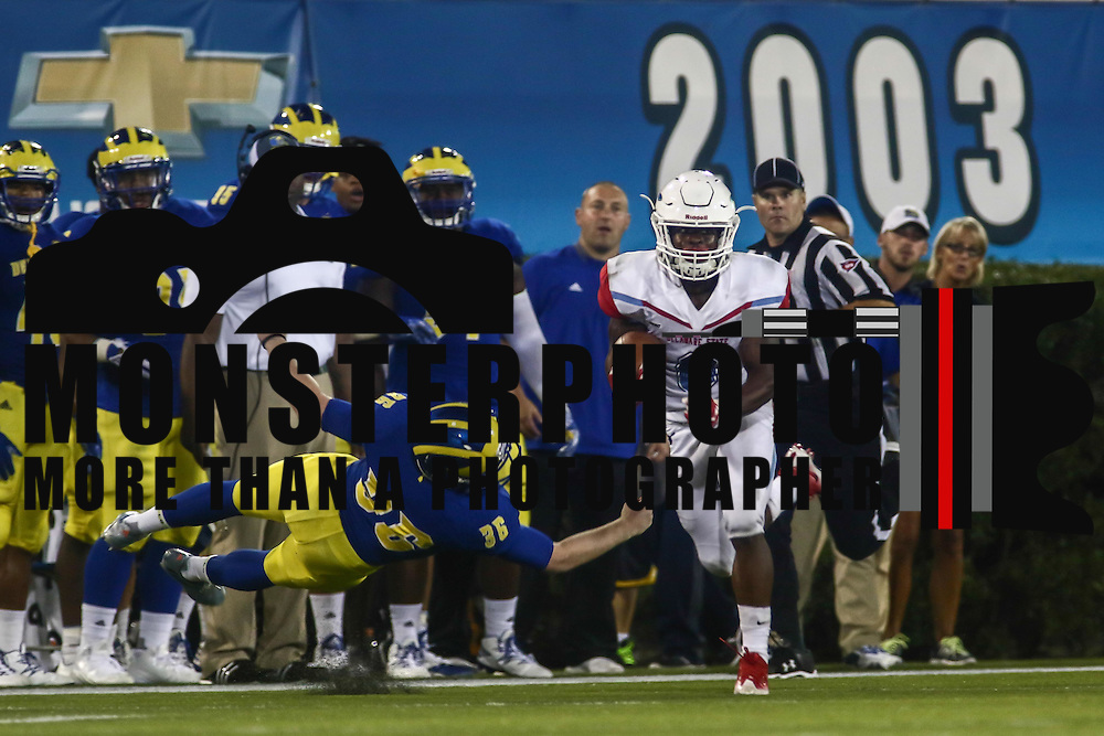 Delaware State Wide receiver BRYCEN ALLEYNE (6) returns the kick 50 yards as Delaware Kicker JAKE ROTH (36) defends during a week one game between the Delaware Blue Hens and the Delaware State Hornets, Thursday, Sept. 01, 2016 at Tubby Raymond Field at Delaware Stadium in Newark, DE.