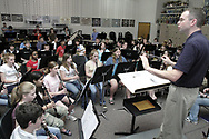 Mr. Frost leads the Ferguson Middle School 8th Grade Band members in a rehearsal at Beavercreek High School, Tuesday, May 1st.