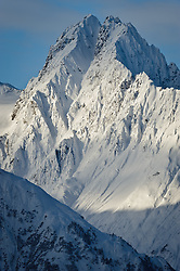 An unamed mountain peak in the Takhinsha Range towers over the Takhin River in southeast Alaska near Haines. The Takhinsha Mountains are a popular heli-skiiing destination.